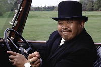 Oddjob crushes a golf ball with his bare hands
